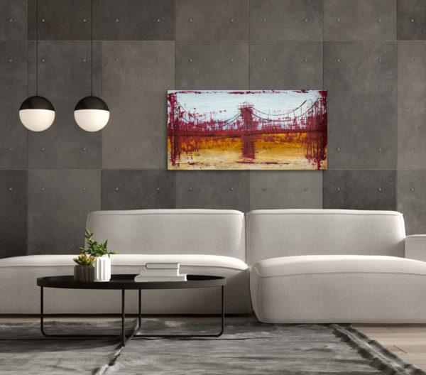 Cuadro con la imagen abstracta de un puente, expuesto sobre la cabecera de el sofá de un salón