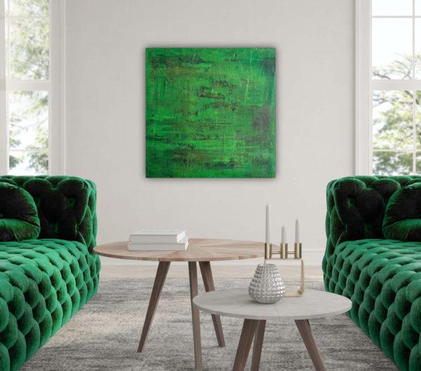 Cuadro abstracto expuesto entre dos sofas de un salón