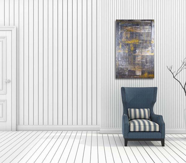 cuadro abstracto acrilico sobre lienzo expuesto sobre un sillón de una habitación diáfana